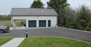 New double garage with carport
